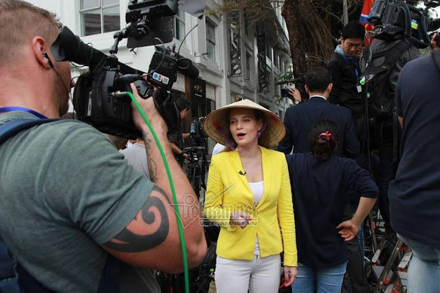The beautiful Russian journalist wearing a Non la (Vietnamese conical hat)