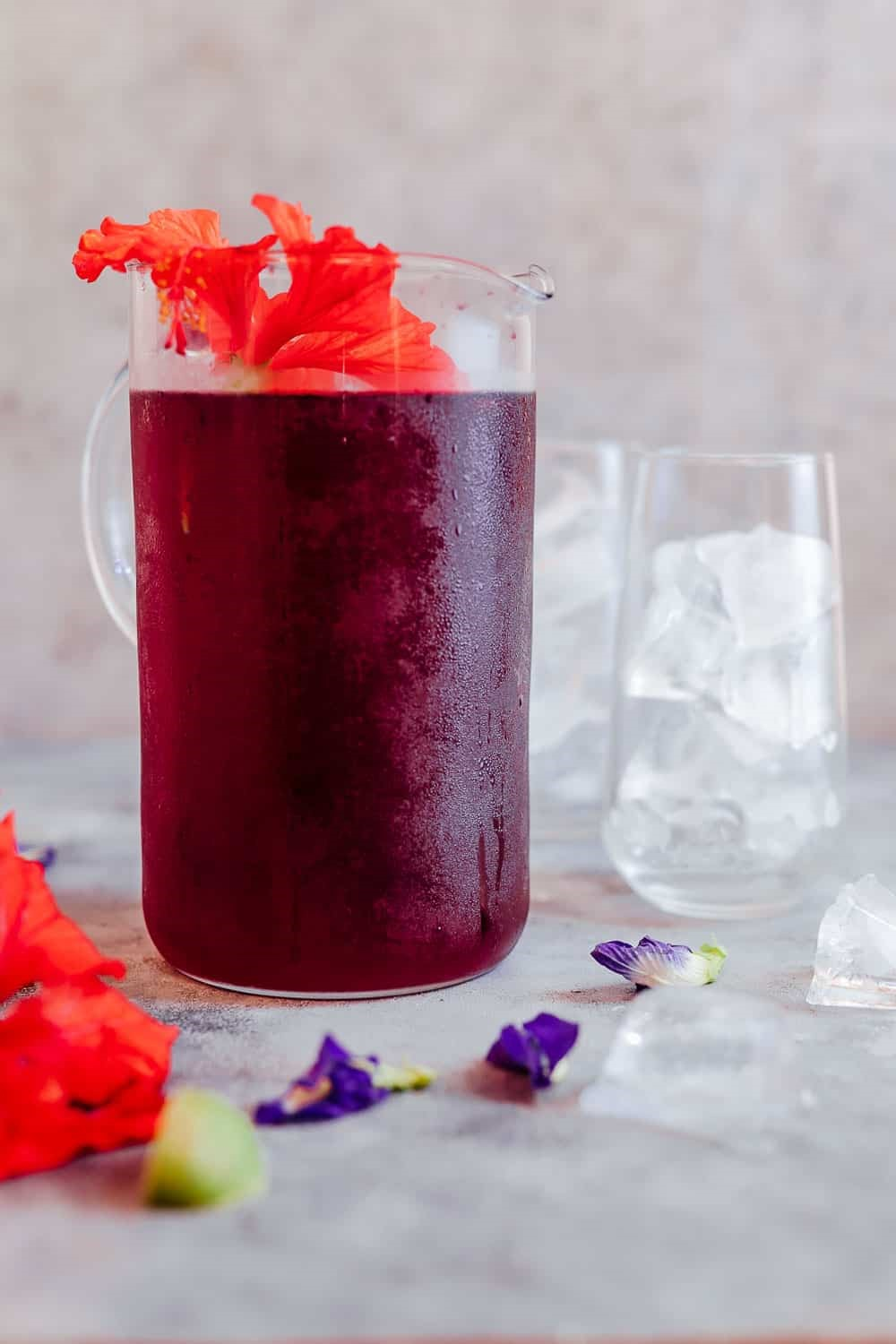Learn how to make hibiscus tea which has some amazing benefits. Make this with either fresh or dried flowers and choose to have it as a hot cup of tea or as hibiscus iced tea because either way it's delicious and really good for you!