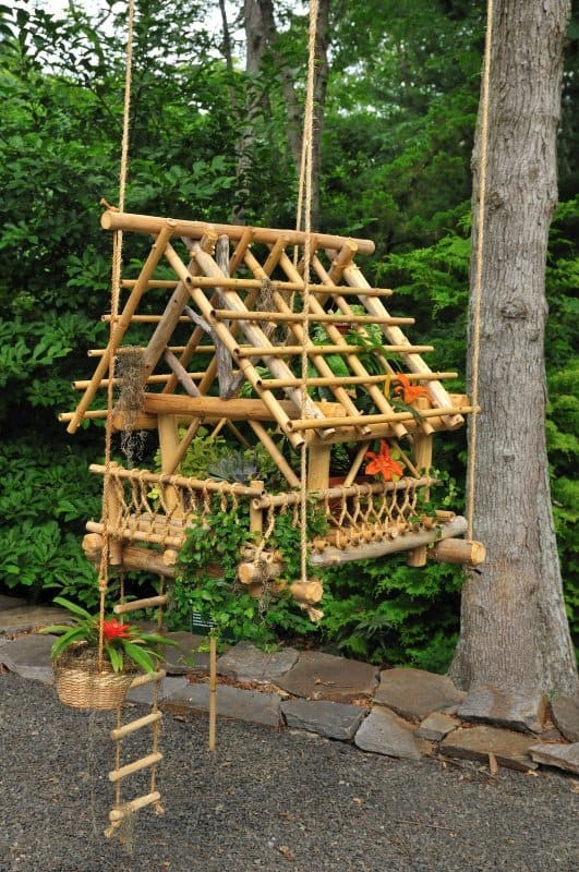 12. Replicate a wooden house in bamboo and nestle plants