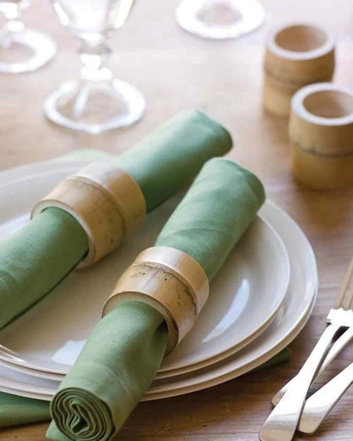 6. An elegant dinner table setting featuring BAMBOO NAPKIN RINGS