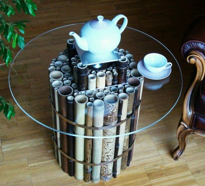 7. Merge different sized bamboo sticks to create the base of a glass coffee table
